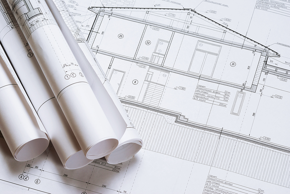 House plan blueprints seen before preforming a home inspection