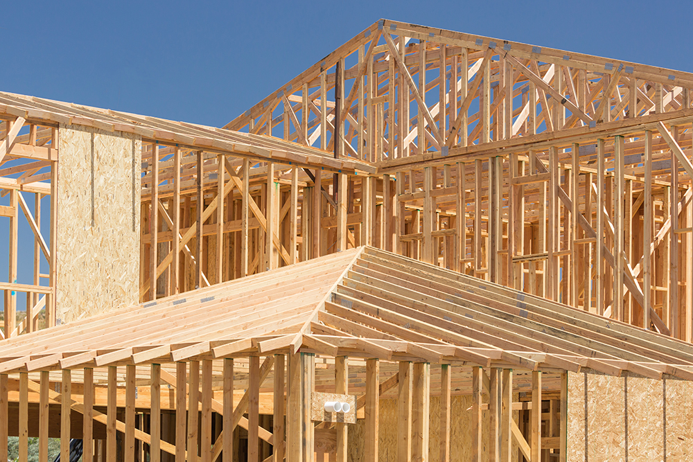 Wood framing of a house being constructed while preforming home inspection services